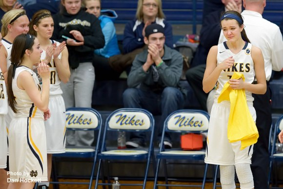 Photo by Dan Hockett Notre Dame's Johanna Myers (right) is brought to tears after New London Teammates presented her with an autographed t-shirt supporting her father Jim Myers' battle with cancer.
