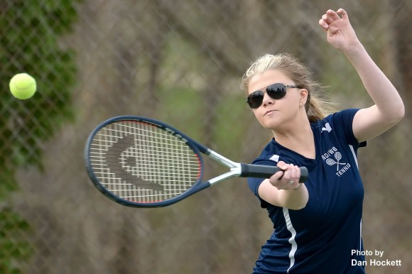 Photo by Dan Hockett Notre Dame – West Burlington's Madison Fry returns the ball during a doubles match with Maharishi Monday afternoon at Dankwardt Park in Burlington. NDWB defeated Maharishi, 9-0.
