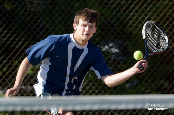 Photo by Dan Hockett Notre Dame – West Burlington's Jarod Fogle returns the ball in a doubles match against Keokuk Monday afternoon in Burlington. Nikes fell to Keokuk, 7-2.