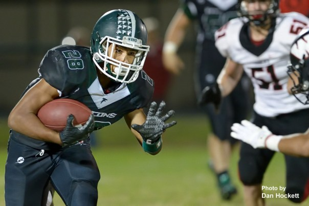 Photo by Dan Hockett West Burlington – Notre Dame Running Back Isaiah Trousil (28) carries the ball against Williamsburg Friday night in West Burlington. Williamsburg defeated the Falcons, 48-12.