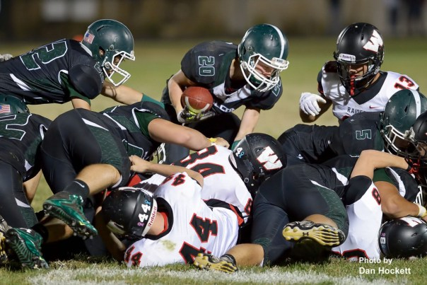 Photo by Dan Hockett West Burlington – Notre Dame's Tanner Snodgrass (20) picks up a fumble before running 52-yards for a touchdown with only 20-seconds remaining in the game against Williamsburg Friday night in West Burlington. Williamsburg defeated the Falcons, 48-12.