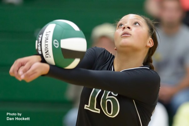 Photo by Dan Hockett West Burlington's Chloe Baker bumps the ball in to play against Cardinal Tuesday night in West Burlington. WB fell to Cardinal, 25-20, 25-21, 22-25, 17-25, 11-15.