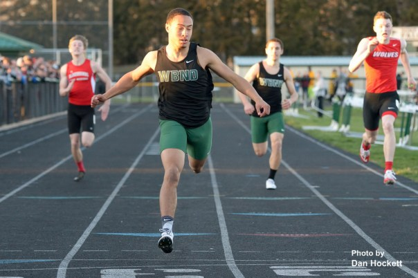 Photo by Dan Hockett Defending State Champ West Burlington – Notre Dame's Isaiah Trousil win the 200-meter dash in 22.13 seconds at the Falcon Relays in West Burlington Monday.