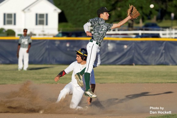 Photo by Dan Hockett Notre Dame's Spencer Ferguson steals second as West Burlington Second Baseman Masin Shullaw corrals a high throw Thursday night in Burlington. Notre Dame defeated West Burlington, 3-1.