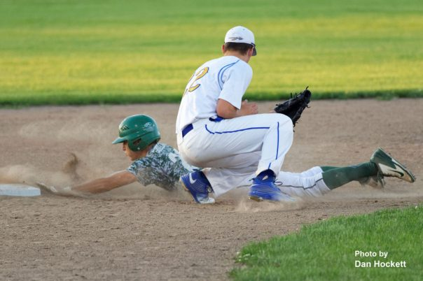Photo by Dan Hockett West Burlington's Masin Shullaw slides safe to second beating the tag by Wapello Shortstop Sam Short in the Class 2A District-10 quarterfinal Saturday night in Wapello. Wapello defeated West Burlington, 2-0.