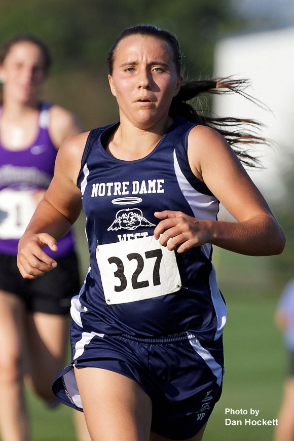 Photo by Dan Hockett Notre Dame – West Burlington's Lexy Davis competes in the Tony Proctor Invitational Cross Country meet in Burlington Thursday afternoon.