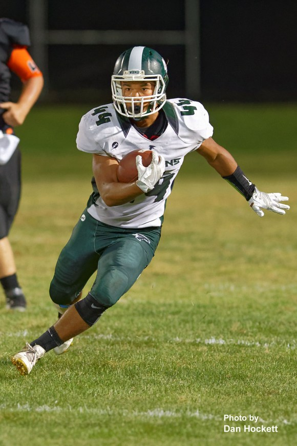 Photo by Dan Hockett West Burlington – Notre Dame Running Back Brian Brem (44) carries the ball against Fairfield Friday night in Fairfield. West Burlington – Notre Dame defeated Fairfield, 20-13.