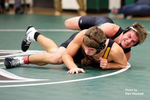 Photo by Dan Hockett Falcon 170-pounder Tyler Hill (top) grapples with New London's Gavin Holmes (bottom) Thursday night in West Burlington. Holmes pinned Hill (3:56). New London defeated WBNDD, 68-6.