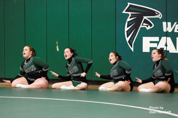 Photo by Dan Hockett Falcon Cheerleaders root for their wrestlers Thursday night in West Burlington. From left: Julia Pross, Allison Boyer, Timber Newman, Lydia Vance.