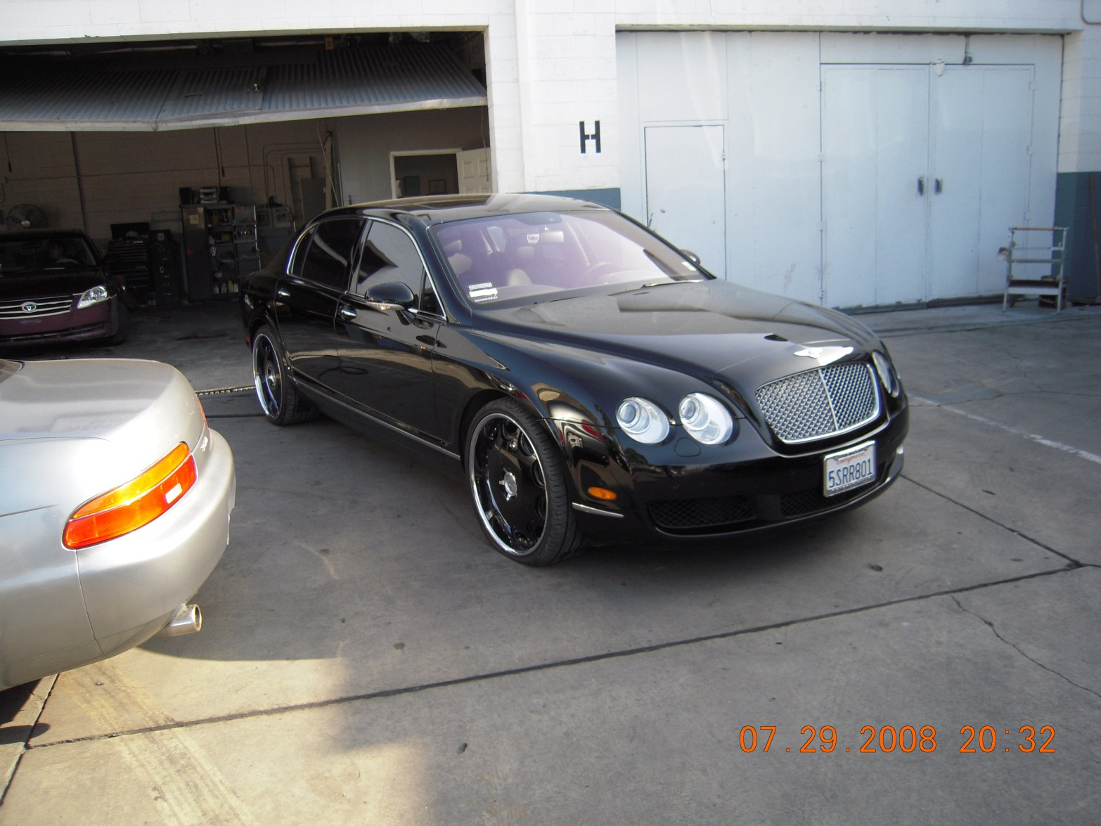 west-coast-body-and-paint-black-bentley-4