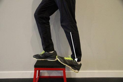 Calf stretch on an elevated platform