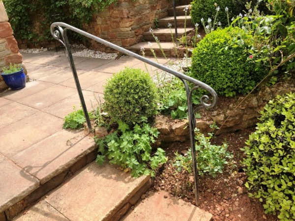 Bespoke metalwork project Bristol by West Country Blacksmiths - Picture shows bespoke handrail with a galvanised and antique etched finish.