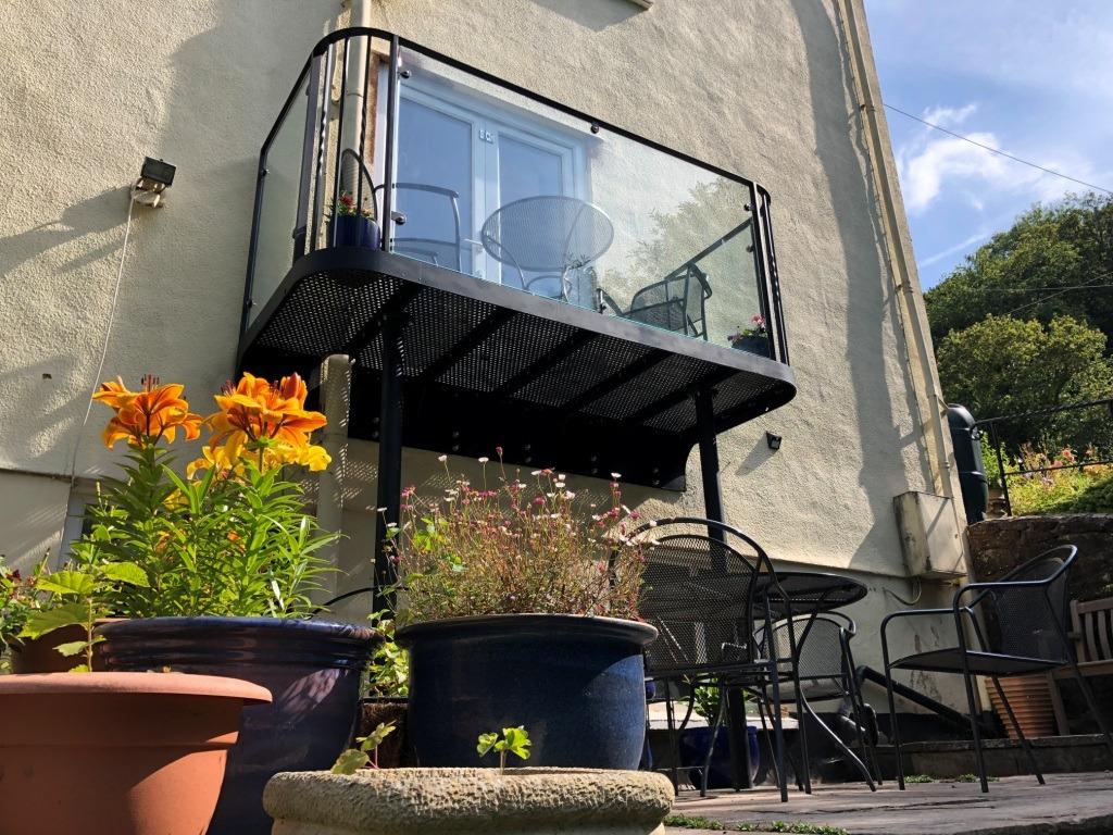 Bespoke metal & glass balcony by West Country Blacksmiths