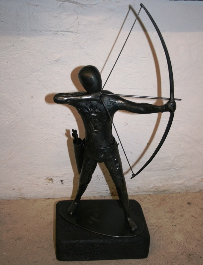 A bespoke archer sculpted from steel and mounted on wood - Bespoke made by West Country Blacksmiths