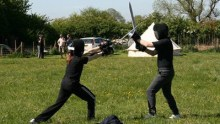 Catling and Pritchard practising sword and bucler at May Melee 2014