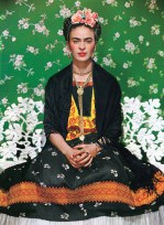 Frida Kahlo on white bench in Nickolas Muray's studio, New York, 1939