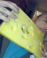 Andrew eats a little cheese