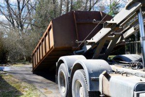 Roll-off dumpster on truck