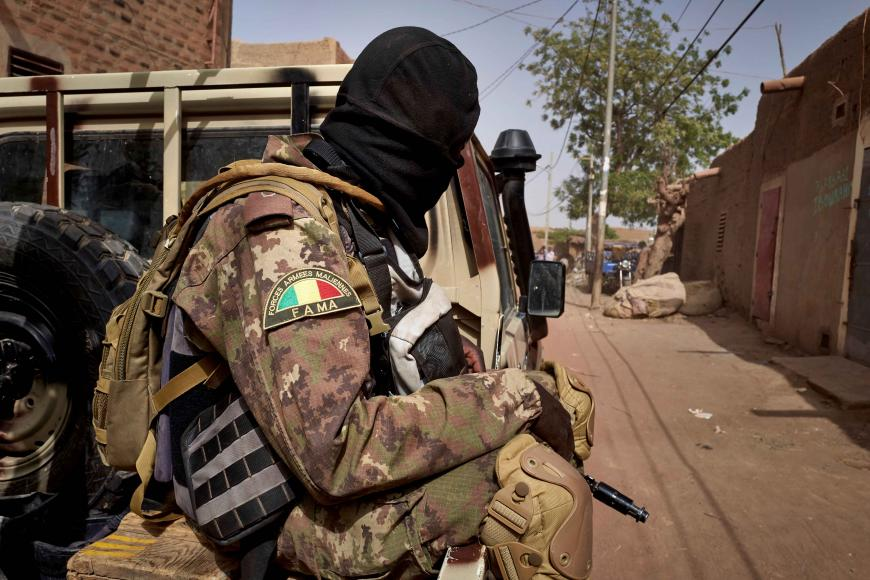 FILE PHOTO: A member of the Malian Armed Forces (FAMA) patrols a road in central Mali, February 2020.