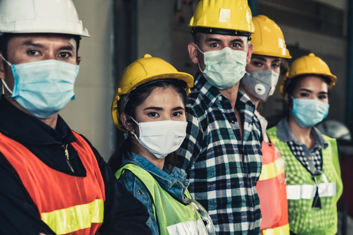 Workers with face mask protect from outbreak of Corona Virus Disease 2019.