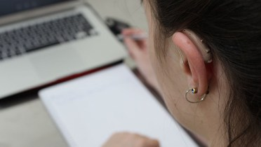 A Deaf student studying