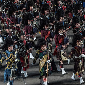 Scotch College Pipe band (middle, marroon uniform) performs at the Tattoo.