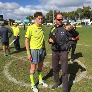 Dean Margetts mentoring a young umpire (Photo: Supplied)