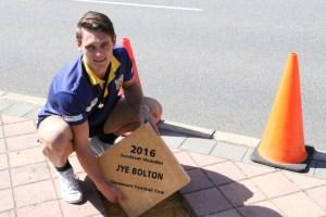 Jye Bolton with his new paver on the Sandover Medal Walk. PHOTO: Matthew Jones.