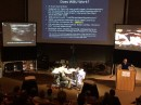 Dr. Arntfield under the gun: challenged by Dr. Mayo to perform a whole body ultrasound in less than 5 minutes in front of 150 people in UH auditorium A.