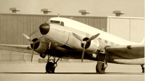 Historical image of propellor airplane at Lewistown Airport