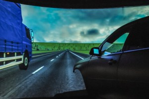 Western Transportation Institute (WTI) Driving simulator laboratory, shows commercial vehicle passing simulator