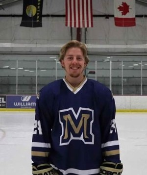 Portrait of Sam Coulter at ice hockey rink 2021