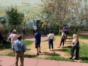Group of students listen to speaker during field trip to Soroptimist Park in Bozeman