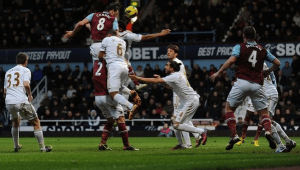 Carroll inspires West Ham to victory over Swansea