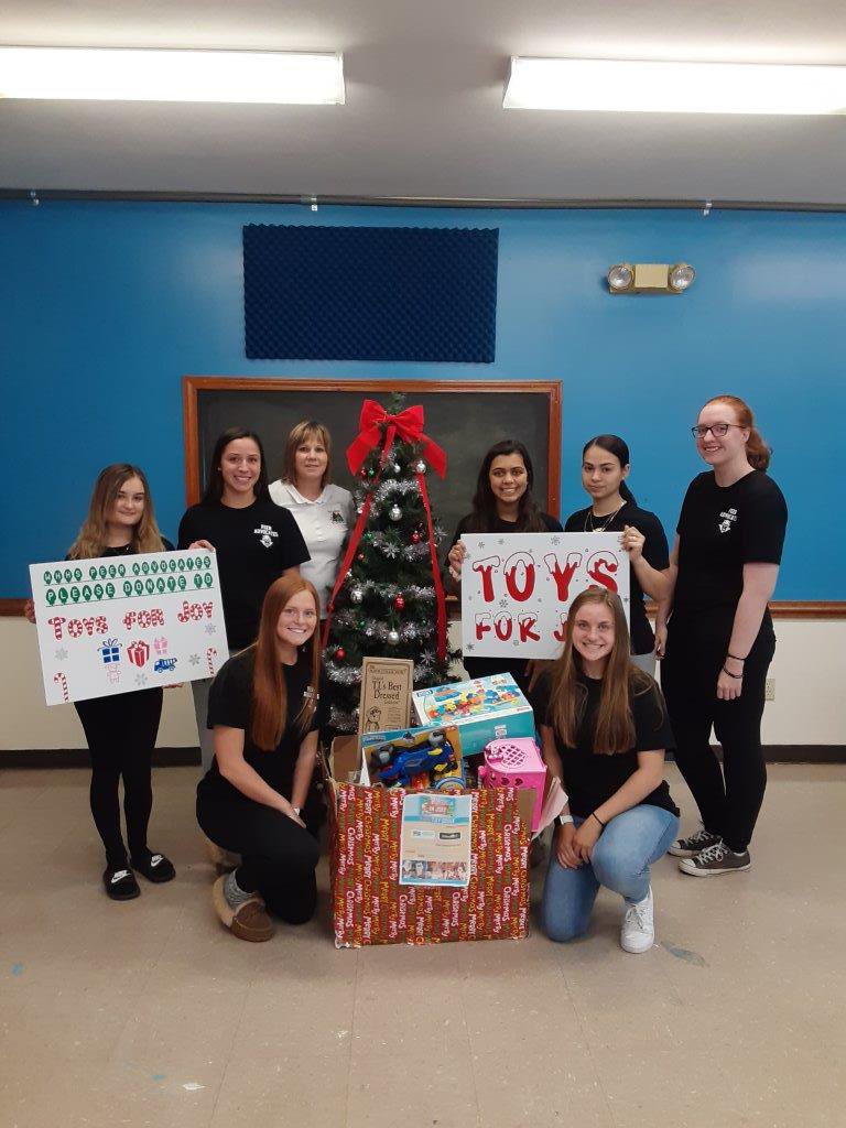Peer advocates give out toys
