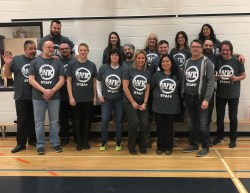 Staff sporting new grey t-shirts.