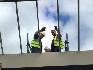 Workmen fix the broken window. Photo: Bramley Baths