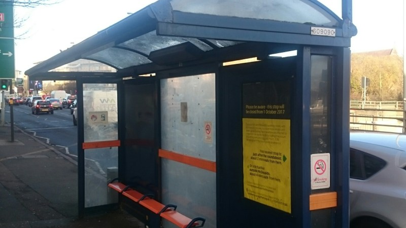 How to report issues with bus stops or shelters