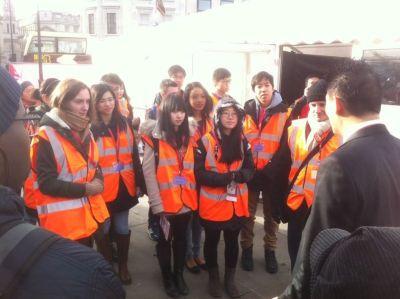 volunteers at morning briefings/ Qiwei Wang