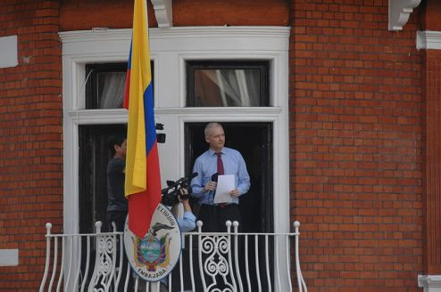 Julian Assange in one of his rare public appearance in the Ecuadorean Embassy in London. Credit to: Wikimedia https://commons.wikimedia.org/wiki/File:Julian_Assange_in_Ecuadorian_Embassy.jpg