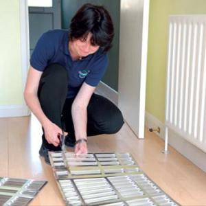 installing insulation behind a radiator