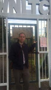 Dan outside locked club gates