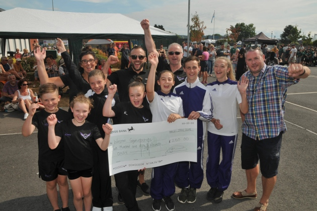 Harry and his team presenting the cheque
