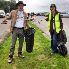 Adam and Sarah clearing up Coca Cola litter.