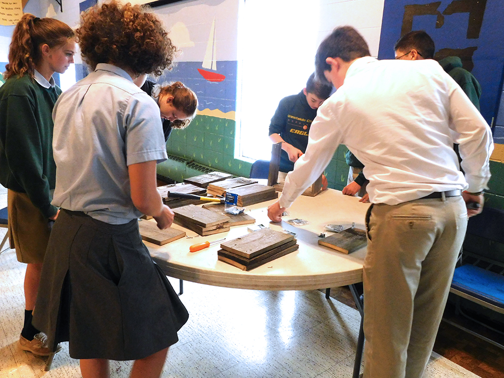 Upper School Students Constructing 20 Year Celebration Centerpieces