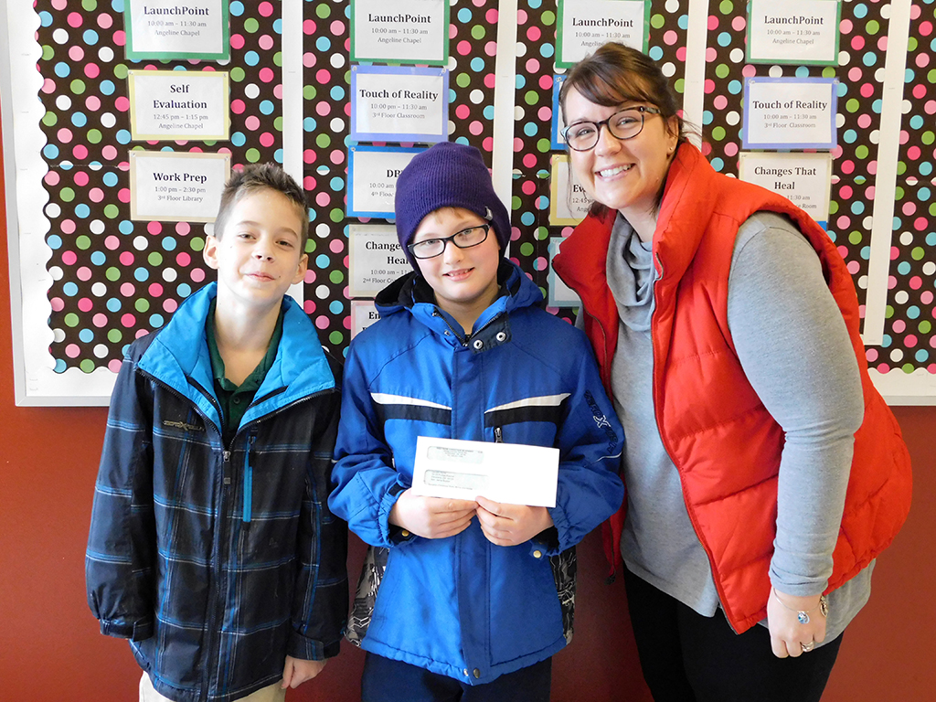 3rd & 4th Grades Present Check to Laura's Home