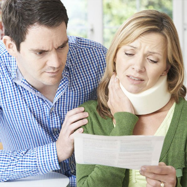 El-Paso-West-Texas-Chiropractor-couple-worried-wife-with-neck-pain-support