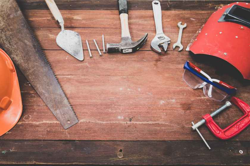 flat lay photography of hand tools