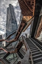 The Vessel structure — part interconnected stairway, part tower, part public art sculpture piece — will stand in the heart of the development's outdoor public space. The Vessel is an elaborate honeycomb-like structure connected staircases between the buildings of Hudson Yards. Designed by Thomas rises 16 stories and consists of 154 flights of stairs, 2,500 steps, and 80 landings, that stretch from its 50-foot-wide base to its 150-foot-wide apex, with the total length of the stairs exceeding 1 mile, that visitors would be able to climb.