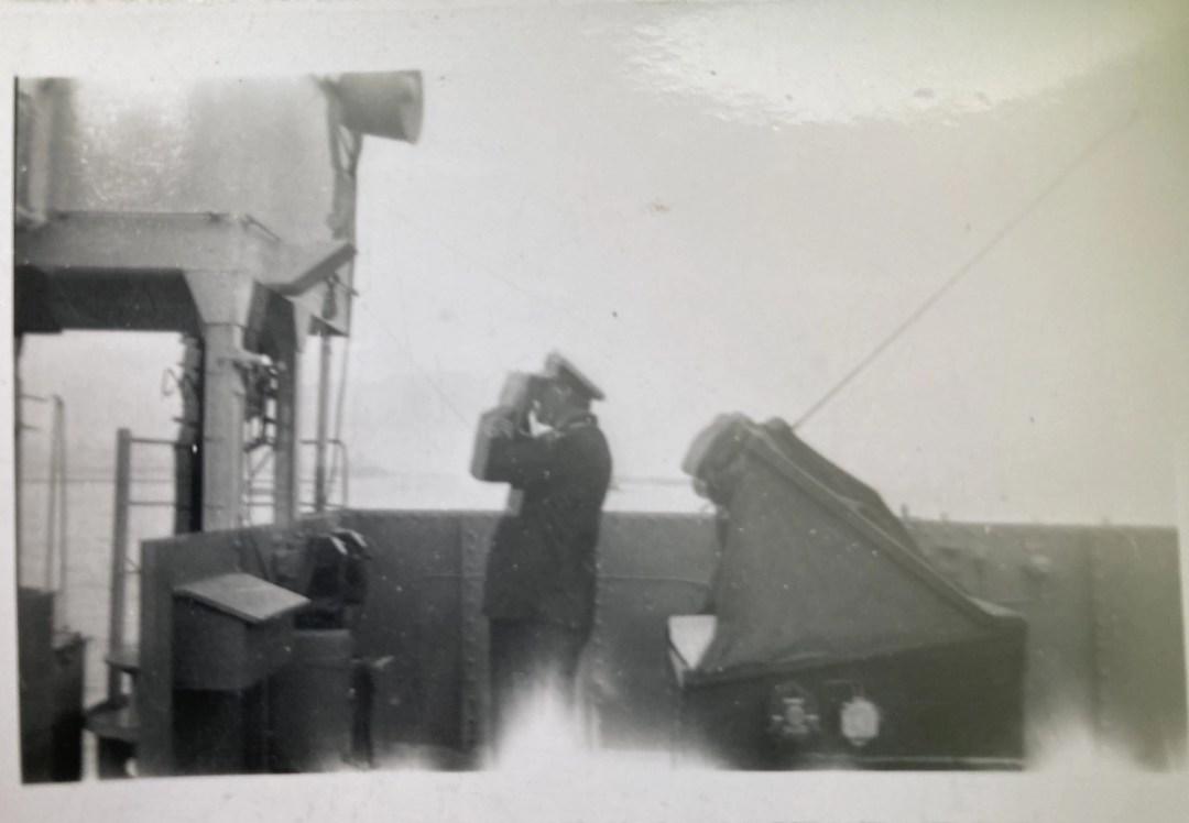 Tony Bird. Commander A J Bell D.S.C. R.N.R on the bridge of HMS LST 3037 (Oran April 1946)